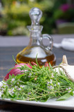Aromatic fresh kitchen herbs, garlic, onion and olive oil, main ingredients for many dishes in medditerranean cuisine - 223461417