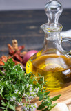 Aromatic fresh kitchen herbs, garlic, onion and olive oil, main ingredients for many dishes in medditerranean cuisine - 223461418