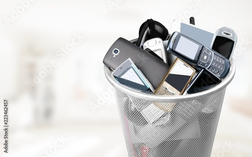 Leinwandbild Motiv Rubbish bin full of old cellphones