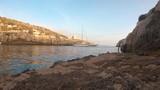 Sailing boat anchored in a narrow bay in Gozo Malta - 223467282