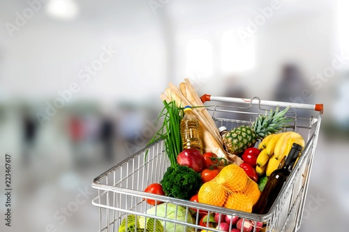 Shopping cart full with various groceries