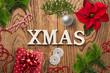 """Leinwanddruck Bild - weihnachtlich Dekoration mit Nachricht """"XMAS"""" auf rustikalem Holzuntergrund"""