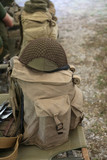 backpack and military helmet of the second world war on the cot - 223481006