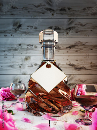 The decanter of brandy on the background of white boards.