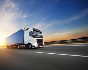 Loaded European truck on motorway in sunset © Jag_cz