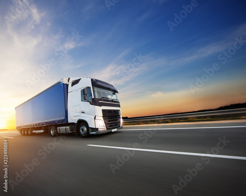Fototapeta Loaded European truck on motorway in sunset