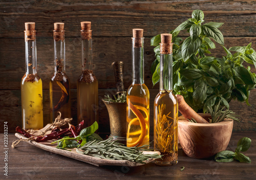 Foto Murales Olive oil with different spices and herbs.