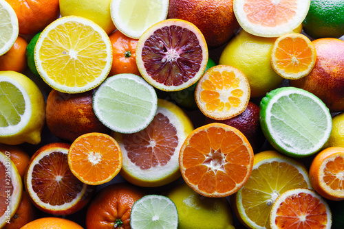 Leinwanddruck Bild Mix of different citrus fruits closeup. Healthy diet vitamin concept. Food photography
