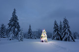 Holiday landscape with Christmas tree, snow and lights in winter mountains. New year celebration concept - 223532206