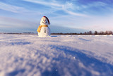 Funny snowman in Santa hat and red scalf on snowy field. Merry Christmass and happy New Year! - 223533652