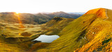 Mountain lake on sunrise time. Picturesque autumn landscape with sun in morning sky, Carpathian mountains - 223534247