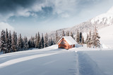 Fantastic winter landscape with wooden house in snowy mountains. Christmas holiday concept. Carpathians mountain, Ukraine, Europe - 223535607