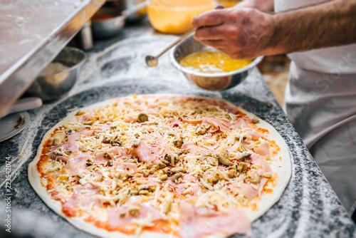 Delicious pizza making.