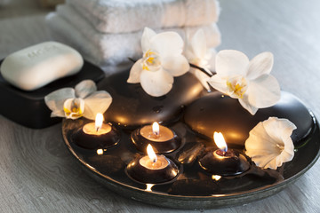 Decorative still life with soap, towels, orchid flowers and candles, perfect for spa, well-being, beauty and relaxation themes © Sunnydays