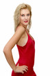 pretty young blonde woman with red dress on white