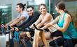 People training on exercise bikes