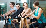 People training on exercise bikes - 223574820