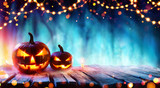 Halloween Party - Pumpkins And String Lights On Table In Dark Forest  - 223588840
