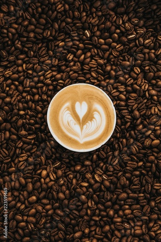 cup of coffee with beans on a background