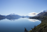 Peaceful view of scenic lake with mountains in the background - 223602460