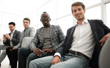 group of young business people are waiting for an interview in the office lobby. - 223605297