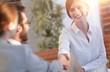 Leinwanddruck Bild - business woman greets the employee with a handshake,