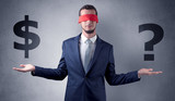 Serious businessmen standing in front of a grey wall with red ribbon on his eye, holding dollars  - 223619085