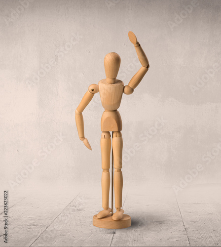 Leinwandbild Motiv Wooden mannequin posed in front of a greyish background