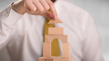 Young handsome businessman using wooden building blocks  - 223623227