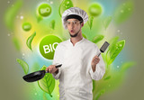 Green bio leaves concept and cook portrait with kitchen tools  - 223627879