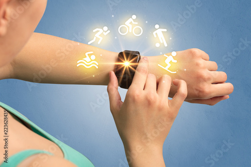 Leinwanddruck Bild Female hand with smartwatch and sport concept.