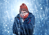 Handsome young boy shivering and trembling at snowstorm concept  - 223634206