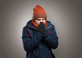 Handsome young boy freezing in warm clothing with copy space - 223634287