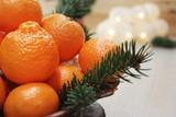 Mandarins and a ceramic plate.Close-up. Copy space.