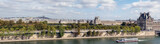 Panoramic view of Paris from Musee d'Orsay rooftop with the Seine, Tuileries Garden, Palais royal, Opera Garnier, Sacre-Coeur and Montmartre hill