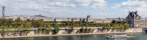 Panoramic view of Paris from Musee d'Orsay rooftop with the Seine, Tuileries Garden, Palais royal, Opera Garnier, Sacre-Coeur and Montmartre hill - 223675646