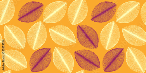 leaves silhouettes seamless pattern in orange and brown shades © L.Dep