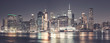 Manhattan skyline at night, color toning applied, USA.