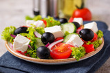 Traditional Greek salad with feta, olives and vegetables - 223687832