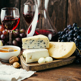 Cheese and wine, Decanter and glasses, wooden background, appetizer, grapes - 223688051
