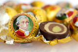 he Mozartkugel, a sweet confection made of chocolate and marzipan, is a culinary specialty of Salzburg named after the famous musican Wolfgang Amadeus Mozart - 223692655