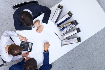 Business people at meeting, view from above. Bookkeeper or financial inspector making report, calculating or checking balance