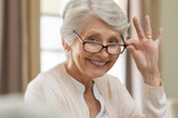 Senior woman holding eyeglasses - 223696494