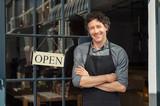 Owner standing outside restaurant - 223696632