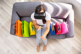 Woman Doing Shopping With Virtual Reality Glasses