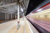 Highspeed train arrives to the station platform. - 223709255