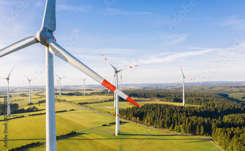 Leinwanddruck Bild Wind turbine from aerial view - Sustainable development, environment friendly, renewable energy concept.