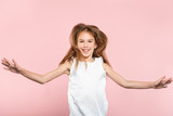 freedom and child carefree lifestyle. smiling young girl jumping spreading hands in the air. excited thrilled child portrait on pink background. - 223748244