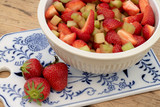 Strawberries and rhubarb pieces in a beautiful bowl - 223764041