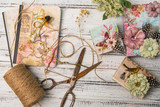 Background with decorated gift boxes, roll of jute and vintage scissors - 223783426
